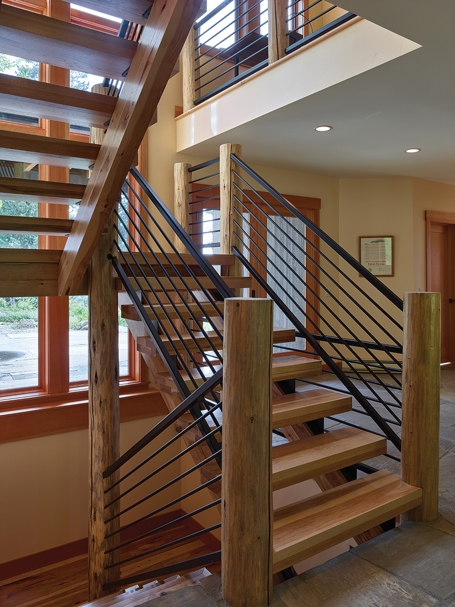 A stairway with hickory treads and Douglas fir newels helps give the house a flow and openness it did not have before.